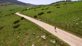 Hilly Terrain With Walking Woman almacen de video
