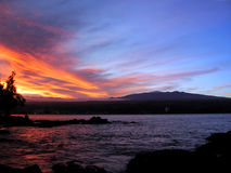 Hilo Mauna Kea Sunset. Winter sunset over Hilo and Mauna Kea on Hawaii's Big Island Stock Photo