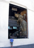 Hilo Puerto Vallarta. Large sculpture in the front window of Hilo is viewed by a tourist on El Malecon in Puerto Vallarta Mexico Royalty Free Stock Image