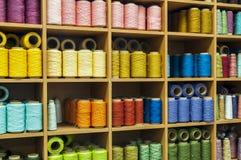 Hilos de coser en una acción Imagen de archivo libre de regalías