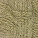 Hilos finos beige naturales textura, primer macro del modelo del ovillo, fondo detallado grande de las lanas Fotografía de archivo