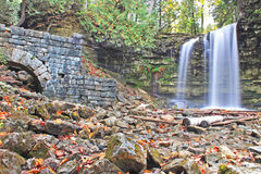 Hilton Falls and Mill Ruins. Hilton Falls is a waterfall located along the Niagara Escarpment on the outskirts of the Greater Toronto Area. The mill ruins to the Royalty Free Stock Photography