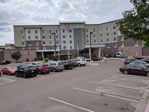 Hilton Garden Inn on the East Bank of the Big Sioux. The Hilton Garden Inn, here pictured with the Sioux Falls Trolley, sits on the east bank of the Big Sioux Royalty Free Stock Images
