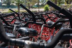 Hilton Head, South Carolina - April 12, 2018: Bicycles for rent. Hilton Head, South Carolina - April 12, 2018: Massive number of black bicycles with red baskets stock photo