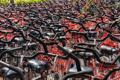 Hilton Head, South Carolina - April 12, 2018: Bicycles for rent. Hilton Head, South Carolina - April 12, 2018: Massive number of black bicycles with red baskets stock photography