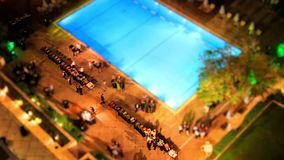 The Hilton hotel swimming pool in central Athens, Greece at night time. Time lapse with tilt shift miniature effect of the Hilton swimming pool in Athens, Greece stock video footage