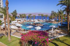 Hilton hotel in Taba. Taba, Egypt - August 10, 2011: Swimming pool in Hilton Hotel in Taba resort town, near the northern tip of the Gulf of Aqaba stock image