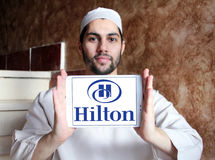 Hilton logo. Logo of hotels chain hilton on samsung tablet holded by arab muslim man Stock Photography