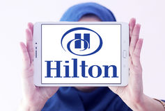Hilton logo. Logo of hotels chain hilton on samsung tablet holded by arab muslim woman Royalty Free Stock Photo