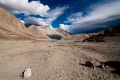 Himalaya desert under dramatic cloudy sky Stock Images