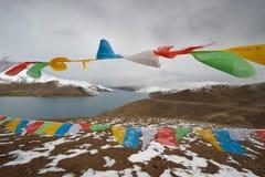 Himalaya lake with Buddhist prayer flags Stock Photography
