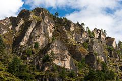 Himalaya Landscape: rocks, trees and Buddhist symbols. Travel to Nepal Royalty Free Stock Photography