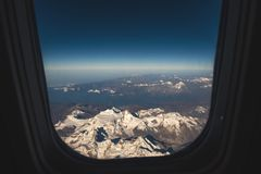 Himalaya mountain and blue sky horizon from airplane window. Top view image of the Himalaya mountain and blue sky horizon from airplane window Royalty Free Stock Image
