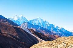Himalaya mountain range against the sky at sunrise, Nepal. Himalaya mountain range against the sky at sunrise. Khumbu valley, Himalayas, Everest region, Nepal stock photos