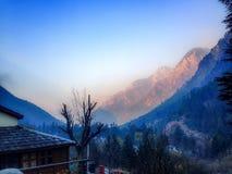 Himalaya mountain view early morning. Himalaya mountain view in magical fog early winter morning in Kasol, Himachal Pradesh, India Stock Images