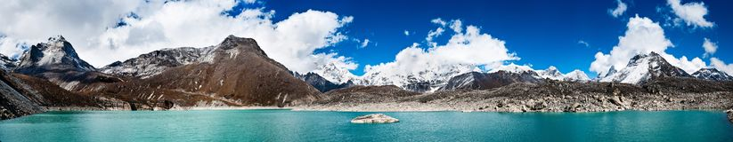 Himalaya panorama: sacred lake near Gokyo and Everest summit. In the right part of the image. Travel to Nepal stock photo