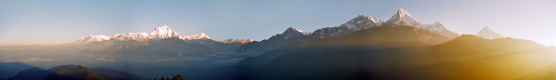 Himalaya Sunrise, Nepal. Sunrise view from the Poon Hill of a misty valley with mount Dhaulagiri and mount Machhapuchhre, Nepal stock image