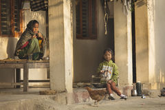 HIMALAYA VILLAGE, NEPAL - NOVEMBER 24: Children of Nepal eating Stock Photography