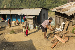 HIMALAYA VILLAGE, NEPAL - NOVEMBER 24: Family house with man cut Stock Photos