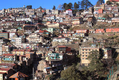 Himalayan cityscape. The image is of hillside view of the town of Shimla in India. Shimla is located in the lower himalayas in India and is the capital of the Stock Photo