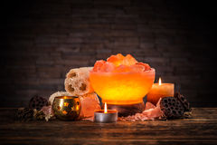 Himalayan crystal lamp. Turned on himalayan crystal natural salt bowl lamp Royalty Free Stock Image
