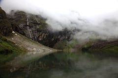 Himalayan glacial lake. Fog filled glacial lake at Hemakund sahib in the Himalayas stock photography