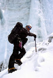 Himalayan ice climber. Climber making his way over the Amphu Labtsa in the Everest region of the Nepalese Himalaya Stock Photo
