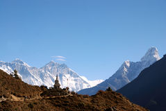 Himalayan Mountains. From left to right, Everest, Lhotse, Ama Dablam, Buddhist chorten in the foreground surrounded by trekkers. Sagarmatha National Park, Nepal Royalty Free Stock Images