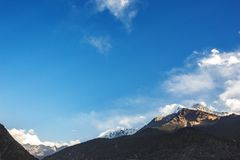 Himalayan mountains and blue sky. Nepal. Silhouette of the Himalayan mountains on blue sky. Nepal royalty free stock photo