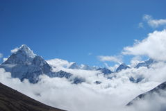 Himalayan Peaks & Clouds. View of several peaks in the Himalaya Mountain range rising above the clouds Stock Photography