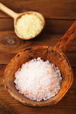 Himalayan Pink Crystal Rock salt in rustic spoon Stock Photos