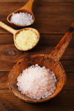 Himalayan Pink Crystal Rock salt in rustic wooden spoon Stock Images