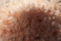 Himalayan pink salt, kitchen ingredient and holistic element. Still life macro photo Royalty Free Stock Images