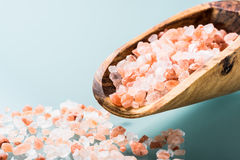 Himalayan pink salt on a olive wood spoon Royalty Free Stock Photography