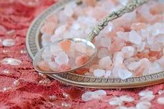 Himalayan pink salt on indian carpet. Himalayan pink salt over indian patchwork carpet Stock Photos