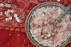 Himalayan pink salt. Over indian patchwork carpet Stock Images