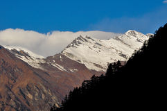 The Himalayan Range. A small portion of himalayan range as seen from Harsil in Gangotri Stock Photo