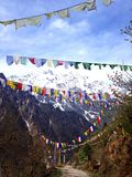 Himalayan Range with snow clad, and mantra flags on The Road at North Sikkim, India Royalty Free Stock Photos