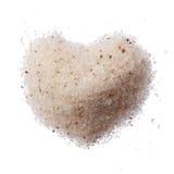 Himalayan roze zout die hart op wit wordt geïsoleerd stock foto