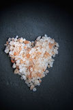 Himalayan salt on a black slice Stock Photography
