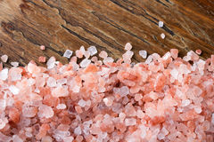 Himalayan salt. Closeup of a Himalayan salt on wooden background - shallow depth of field Royalty Free Stock Image