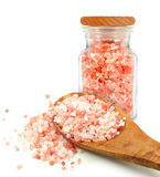 Himalayan salt. In a jar and spoon isolated on white background Stock Photo