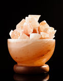 Himalayan salt lamp isolated on the black background Stock Photography