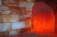 Himalayan Salt Stones and Bricks. Himalayan salt lamp and wall in a halotherapy spa Royalty Free Stock Images