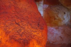 Himalayan Salt Stones and Bricks. Himalayan salt lamp and wall in a halotherapy spa Stock Image