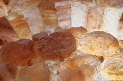 Himalayan Salt Stones. Himalayan salt wall in a halotherapy spa Royalty Free Stock Photo