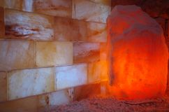 Himalayan Salt Stones. Himalayan salt wall and lamp in a halotherapy spa Royalty Free Stock Images
