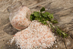 Himalayan salt on a wooden board Royalty Free Stock Images