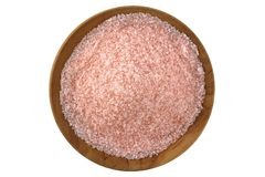 Himalayan salt in a wooden bowl Stock Photos