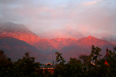 Himalayan sunset from dharamsala india. Himalayan sunset  sets the mountains aflame in surreal colors  as  viewed from dharamsala india Stock Photos